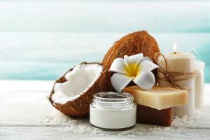 Organic coconuts and coconut oil on display at the beach.